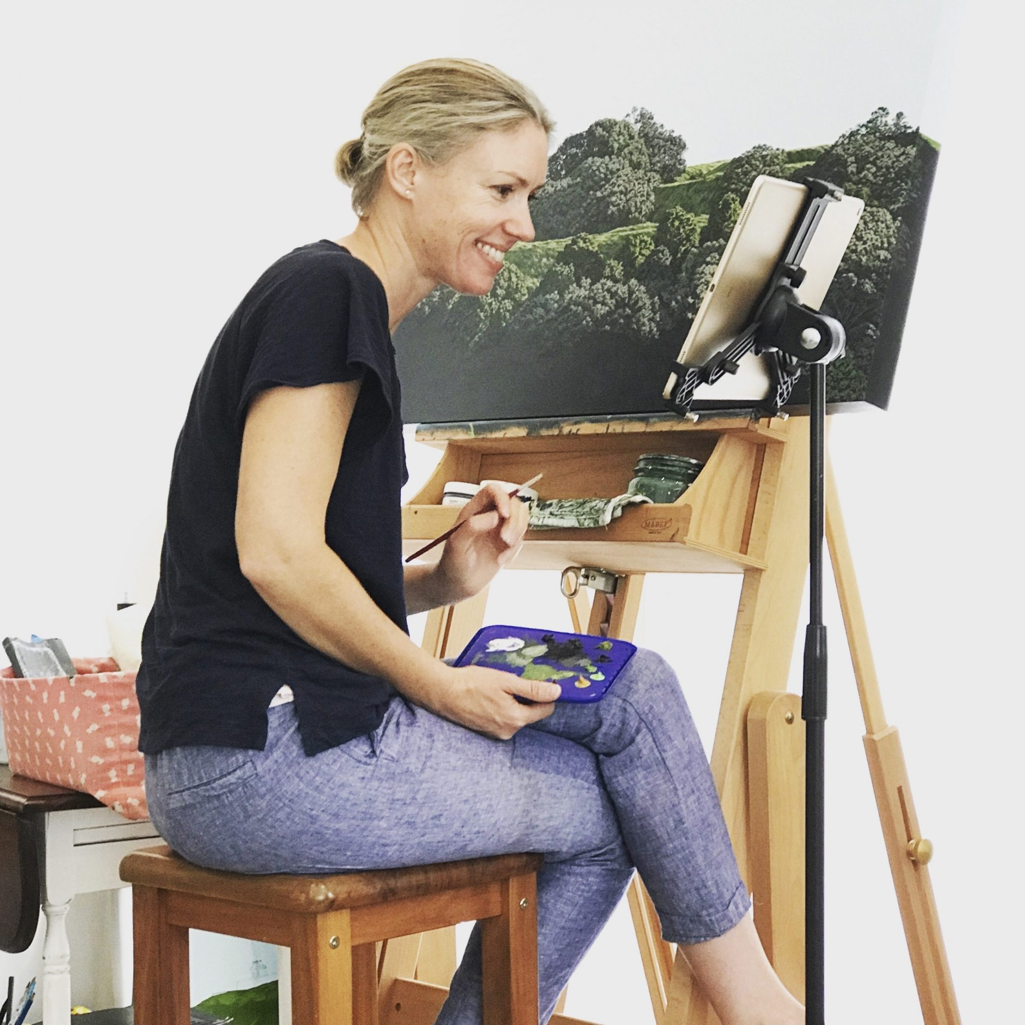 Picture of Sara Langdon painting at an easel